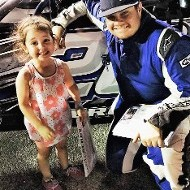 Racer with Little Girl